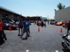 The scene in the parking lot. Plenty of Italian dream machines, 2 wheels and 4, to check out.